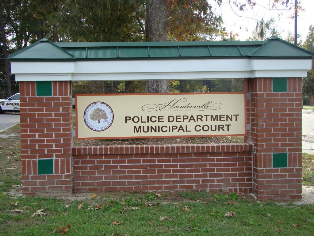 "A brick sign which reads, ""Hardeeville Police Department and Municipal Court."""